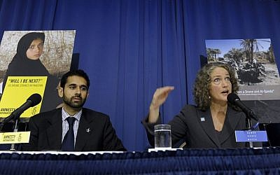 Letta Tayler, senior counterterrorism researcher at Human Rights Watch, right, accompanied by Mustafa Qadri, a Pakistan researcher at Amnesty International, talks about the findings of two new reports, by the two human rights groups, on US drone strikes and other air strikes in Pakistan and Yemen in Washington, DC on  Oct. 22, 2013 (photo credit: AP/Susan Walsh)