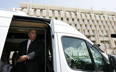 Dani Dankner, former head of Bank Hapoalim, leaving the Bank of Israel in 2009. Dankner was convicted of fraud on Thursday and ordered to pay a hefty fine. (photo credit: Kobi Gideon/Flash90)
