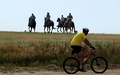 Head out biking -- or riding -- this fall (photo credit: Moshe Shai/Flash 90)