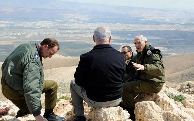 Prime Minister Benjamin Netanyahu (back to camera), visiting the Jordan Valley in 2011. (photo credit: Moshe Milner/GPO/Flash90)
