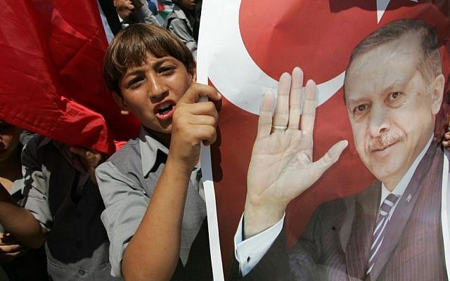 Palestinian students hold up pictures of Turkish Prime Minister Recep Tayyip Erdogan as they wave the Turkish and Palestinian flags during a rally in Gaza, in 2011 (photo credit: Abed Rahim Khatib/Flash90)