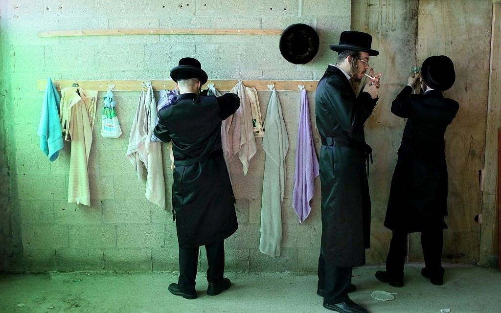 Men preparing to dip in a ritual bath in the city of Beit Shemesh before Yom Kippur (photo credit: Nati Shohat/Flash 90)