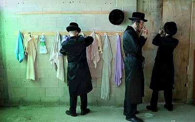 Men preparing to dip in a ritual bath in the city of Beit Shemesh before Yom Kippur (photo credit: Nati Shohat/Flash 90)