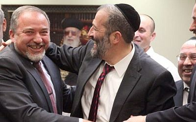 Yisrael Beytenu head Avigdor Liberman (left) and Shas leader Aryeh Deri at a celebration in honor of Deri's birthday, in the Knesset, February 18, 2013. (photo credit: Flash90)