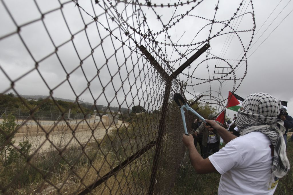 Palestinians protesting the security fence. (Illustrative photo: Issam Rimawi/Flash90)