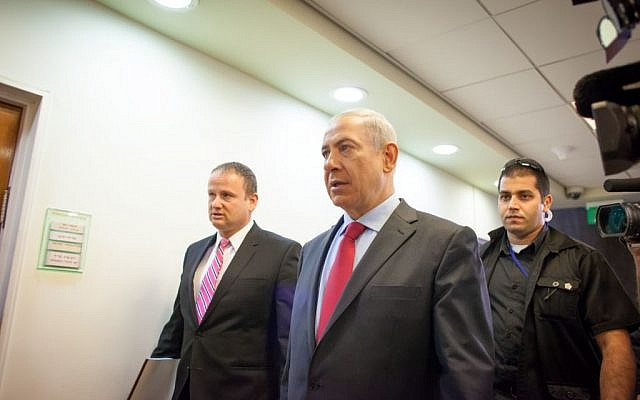 Benjamin Netanyahu walking to a Cabinet meeting earlier this week. (photo credit: Emil Salman/POOL/Flash90)
