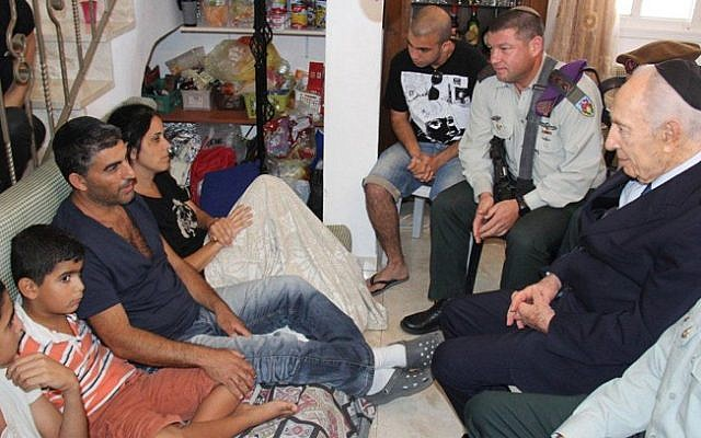 President Shimon Peres visits the Kobi family, whose son Gal was killed in Hebron, September 27 (photo credit: Yosef Avi Yair Engel/Flash90)