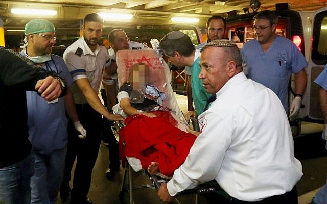 Noam Glick being brought to Shaare Zedek Medical Center in Jerusalem on October 5. (photo credit: Flash90)
