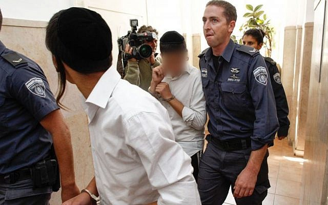 Arrested Jewish youths arriving in court in Jerusalem, on Sunday, October 6. (photo credit: Flash90)
