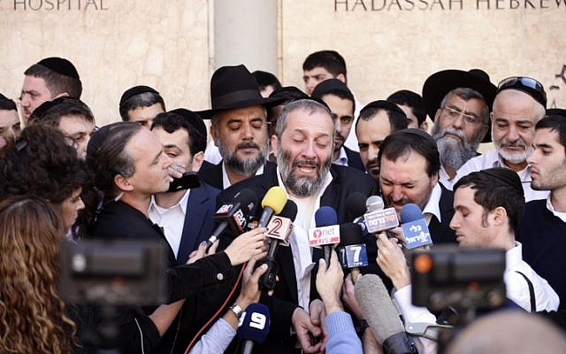 MK Aryeh Deri, who said he felt 'orphaned' by the loss, reacts to Rabbi Ovadia Yosef's death (Photo credit: Flash 90)