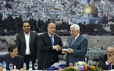 Labor MK Hilik Bar (center) with Palestinian Authority President Mahmoud Abbas during a meeting between Palestinian politicians and Israeli MKs in Ramallah, October 07, 2013. Isaac Herzog, elected Labor leader in November 2013, is seated at left. (photo credit: Flash90)