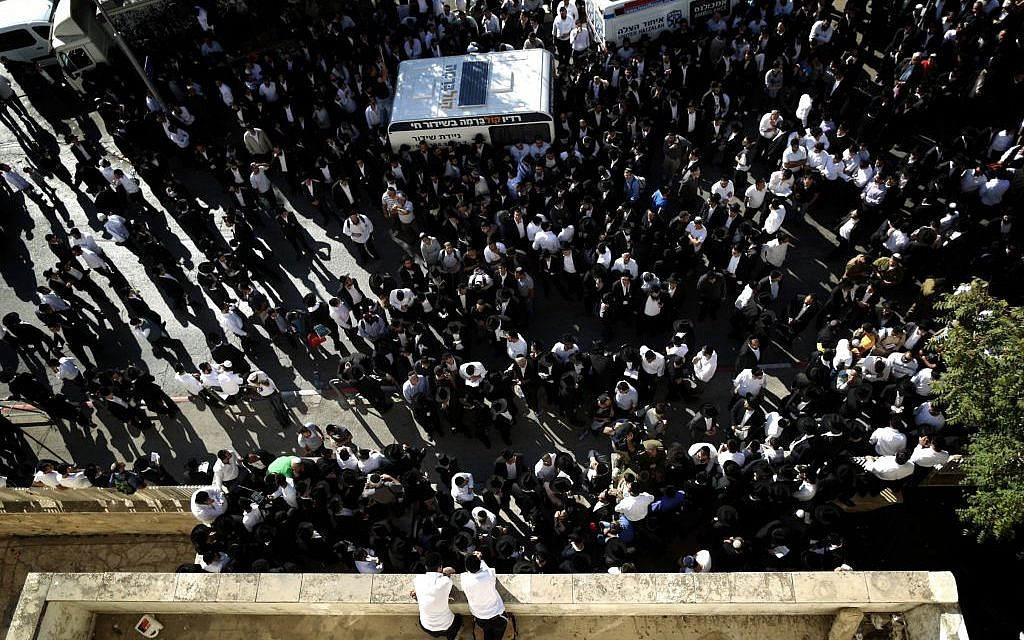 Mourners gather outside the Porat Yosef yeshiva in Jerusalem for the funeral of Rabbi Ovadia Yosef, on October 7, 2013. (photo credit: Yonatan Sindel/Flash90)