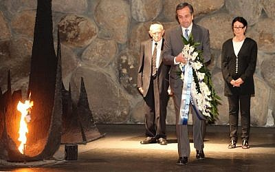 Greek Prime Minister Antonis Samaras lays a wreath in the Hall of Remembrance seen during a visit at the Yad Vashem Holocaust Memorial Museum in Jerusalem on October 08, 2013. (photo credit: Isaac Harari/FLASH90)