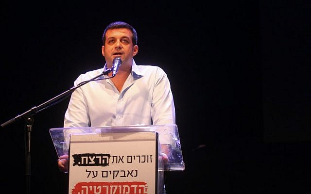 Yonatan Ben Artzi, Yitzhak Rabin's grandson, speaks at a rally in Rabin Square in Tel Aviv, October 12, 2013, marking 18 years since the assassination of the prime minister (photo credit: Roni Schutzer/FLASH90)