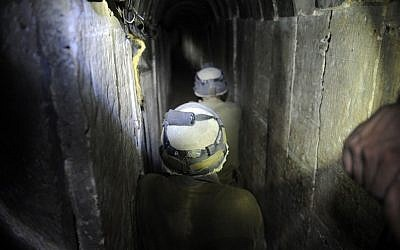 An Israeli soldier walks through a tunnel dug by Palestinians beneath the border between the Gaza Strip and Israel, uncovered by Israeli troops, on October 13, 2013. (\David Buimovitch/Flash90)