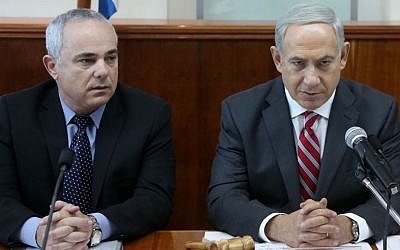 Prime Minister Benjamin Netanyahu (R) and Minister of Strategic Affairs Yuval Steinitz during the weekly cabinet meeting, at the Prime Minister's Office in Jerusalem, on October 13, 2013. (photo credit: Marc Israel Sellem/POOL/Flash90)