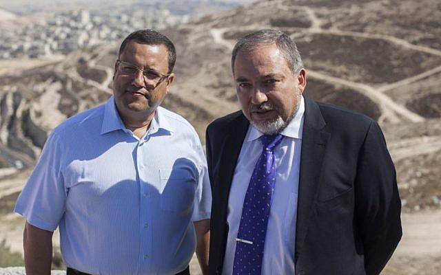Moshe Lion (L) with Avigdor Liberman during a tour near the Mount Scopus National Park in Jerusalem on October 14, 2013 (photo credit: Yonatan Sindel/Flash90)