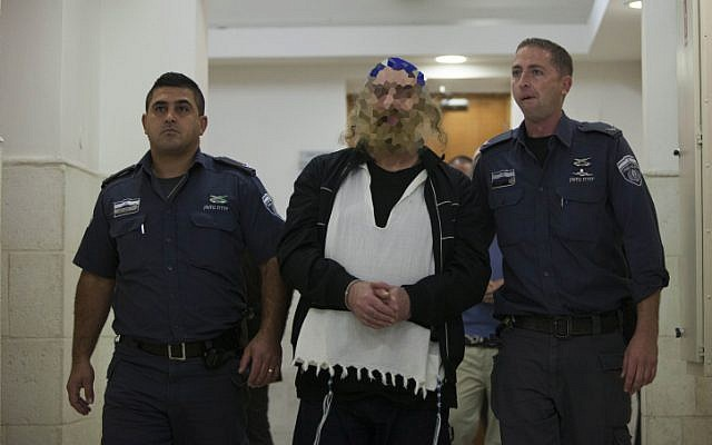 A man is escort by police at Jerusalem District Court after being sentenced to prison as the head of sadistic cult on October 17, 2013. (photo credit: Yonatan Sindel/Flash90)