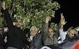 Palestinian Authority President Mahmoud Abbas, second from left, waves with released Palestinian prisoners coming from Israeli jails during celebrations at Abbas's headquarters in the West Bank town of Ramallah, October 30, 2013. (Issam Rimawi/Flash90)