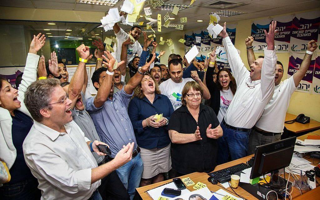 Supporters of Haifa mayor Yona Yahav celebrating his victory Tuesday. (photo credit: Avishag Shaar Yashuv/Flash90)
