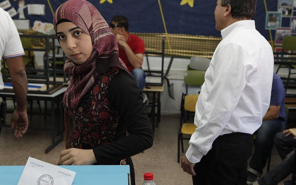 A woman voting in Kfar Kassem Tuesday. (photo credit: Flash90)