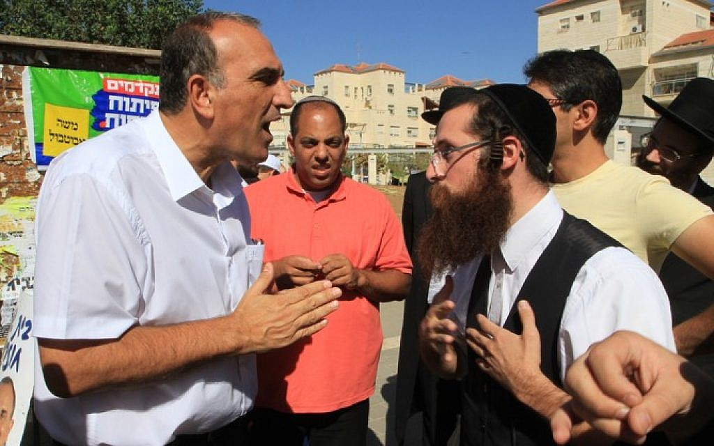 This must be good for you -- Beit Shemesh men arguing over politics in the lead-up to elections, October 2013. (photo credit: Yaakov Lederman/Flash 90)