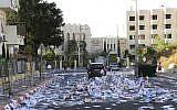 A street in Jerusalem filled with election fliers on October 21, 2013. ( Yaakov Lederman/Flash90)