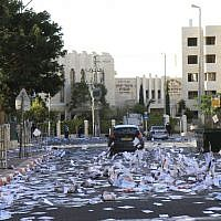A street in Jerusalem filled with election fliers on October 21, 2013. ( Yaakov Lederman/Flash90)