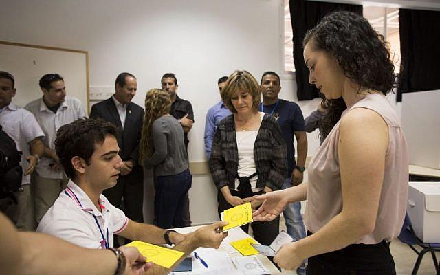 Danielle Barkat, daughter of Jerusalem's mayor, votes in Jerusalem Tuesday. (photo credit: Yonatan Sindel/Flash90)