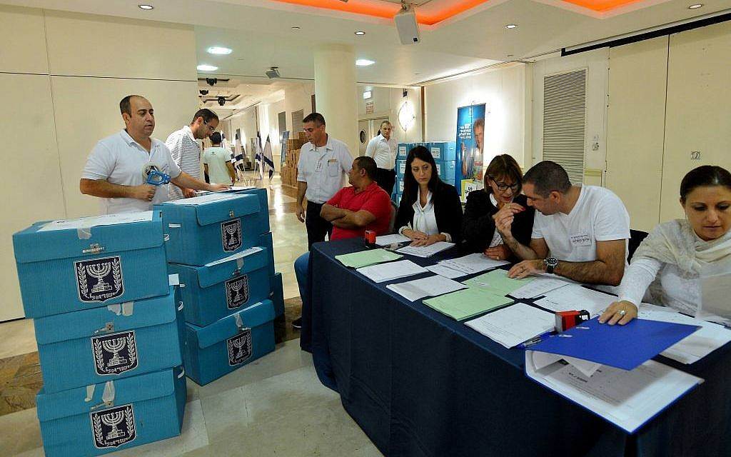 Ballots are brought to be counted Tuesday evening (photo credit: Yossi Zeliger/Flash90)