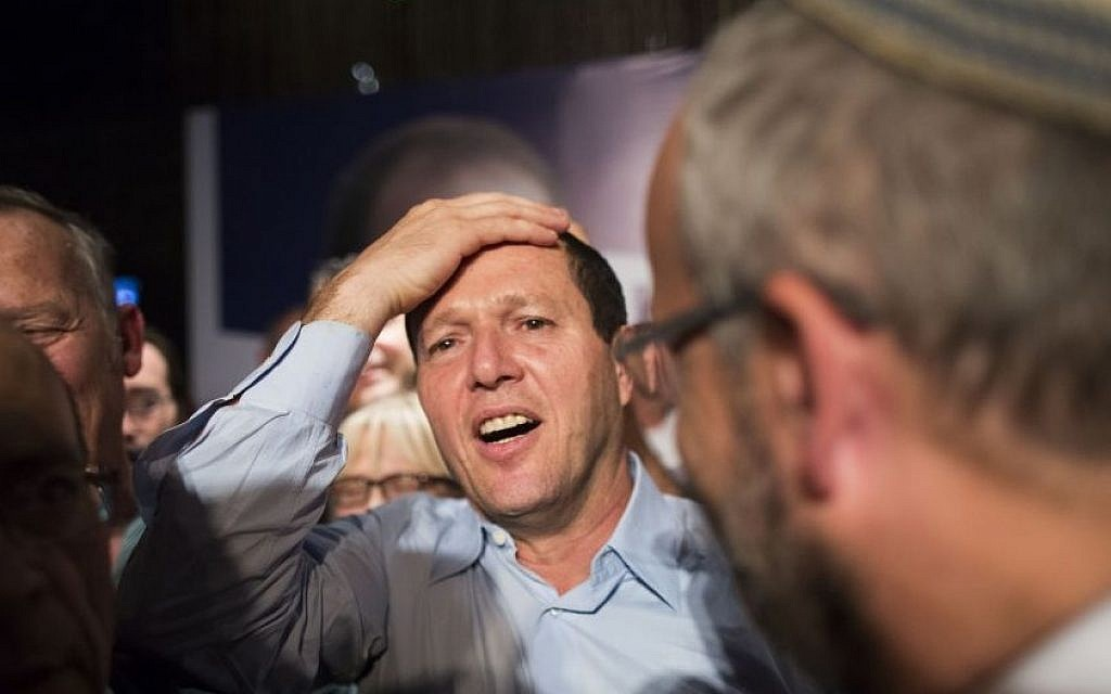 Nir Barkat celebrates with supporters after winning the Jerusalem mayoral elections, early on October 23, 2013 (Photo credit: Yonatan Sindel/Flash90)