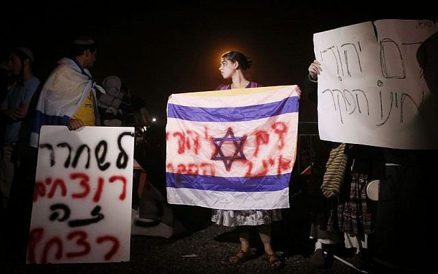 Israelis protesting outside Ofer Prison against previous release (photo credit: Miriam Alster/Flash90)