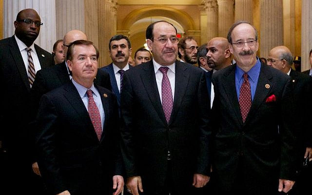 Iraqi Prime Minister Nouri al-Maliki, center, walks with ranking members of the House Foreign Affairs Committee, in Washington, DC, Wednesday (photo credit: AP/Molly Riley)