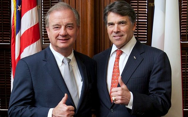 Texas Governor and former Republican presidential candidate Rick Perry, right, posing for a photo with Texas A&M University System Chancellor John Sharp (photo credit: courtesy Texas A&M University)