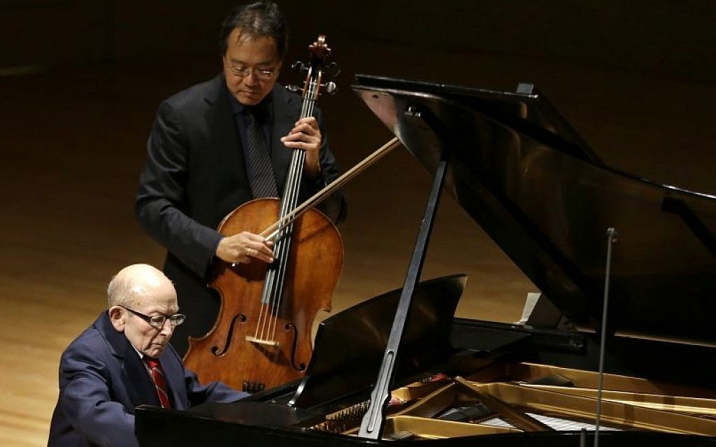 Holocaust survivor George Horner, front left, performs with cellist Yo-Yo Ma, top, on stage at Symphony Hall Tuesday, Oct. 22, 2013, in Boston. (photo credit: AP Photo/Steven Senne)