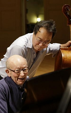 Cellist Yo-Yo Ma, rear, rehearses with Holocaust survivor George Horner on stage at Symphony Hall Tuesday, Oct. 22, 2013, in Boston. (photo credit: AP Photo/Steven Senne)
