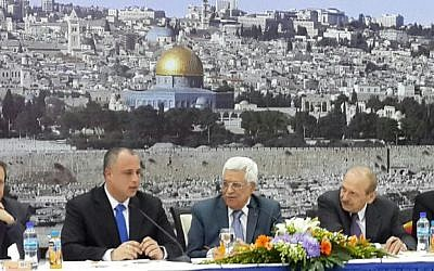 Labor Party MKs Isaac Herzog and Hilik Bar sit to the right of Palestinian Authority President Mahmoud Abbas (center) and other PA officials in Ramallah, Monday, October 7, 2013 (photo credit: courtesy)