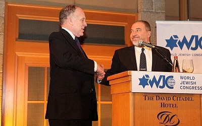 World Jewish Congress President Ronald S. Lauder, left, shakes hands with MK Avigdor Liberman (photo credit: Shimon Arbiv)