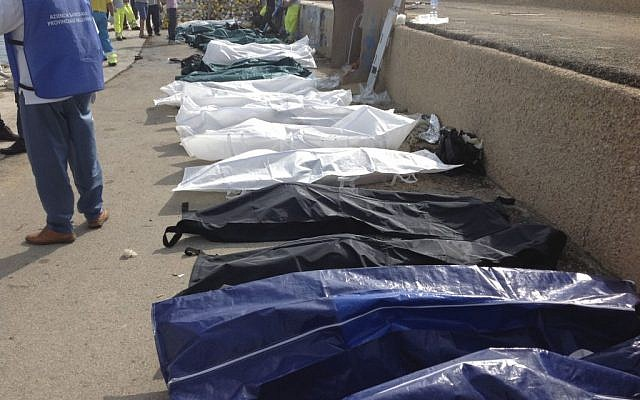 Bodies of drowned migrants are lined up in the port of Lampedusa Thursday, October 3, 2013. (photo credit: AP/Nino Randazzo, Health Care Service, HO)