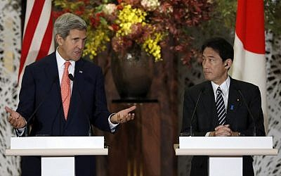 US Secretary of State John Kerry (left) and Japan's Foreign Minister Fumio Kishida (right), in Tokyo, Thursday (Issei Kato/AP Pool)