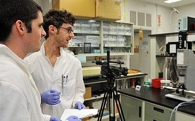Researchers videotaped by the Journal of Visualized Experiments in Boston (photo credit: courtesy)