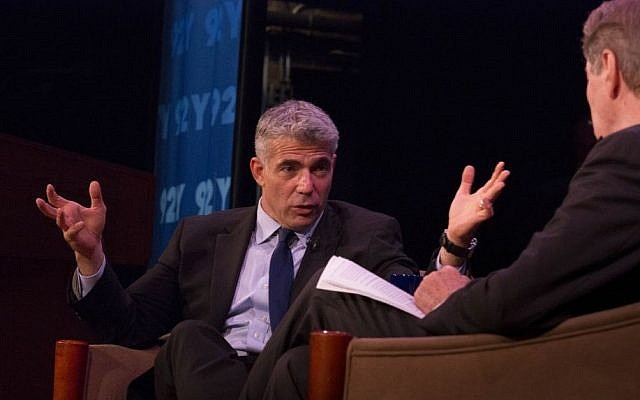Yair Lapid speaks to Charlie Rose in New York, Monday, October 7, 2013 (photo credit: Joyce Culver)
