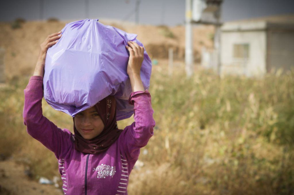 A refugee at the camp near Al-Mafraq carries her goods. (photo credit: Mickey Alon)
