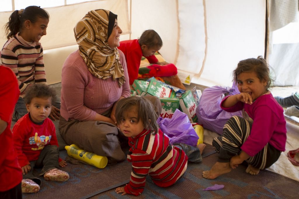 A Syrian mother and her children inside a UNHCR tent. (photo credit: Mickey Alon)