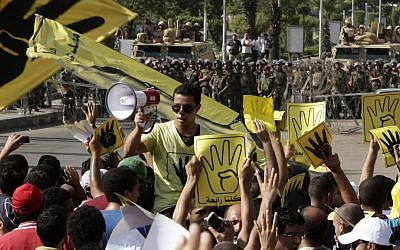 Supporters of Egypt's ousted president Mohammed Morsi chant slogans in Cairo, Egypt, during a demonstration earlier this month (photo credit: AP/Hassan Ammar)
