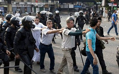 In this Sunday, Oct. 6, 2013 file photo, supporters of ousted president Mohammed Morsi are detained during clashes with riot police in Cairo, Egypt. (AP Photo/Nameer Galal, Fil)