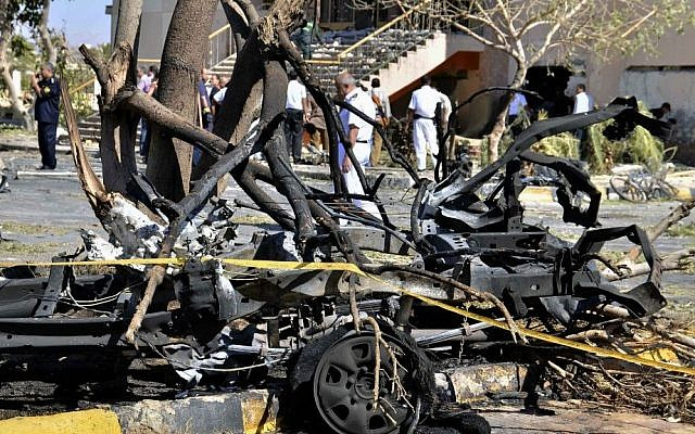 The site of a deadly suicide car bombing targeting a security headquarters in the southern Sinai town of el-Tor, Egypt, on Oct. 8, 2013.  (photo credit: AP/Mostafa Darwish)