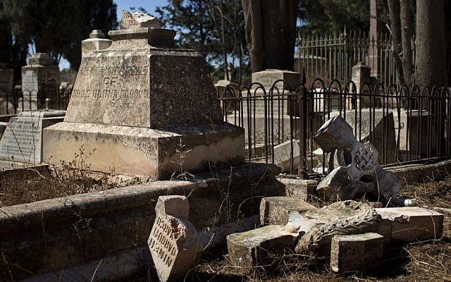 A damaged grave in the Protestant Cemetery of Mt. Zion, Jerusalem, on Monday (photo credit: AP/Bernat Armangue)