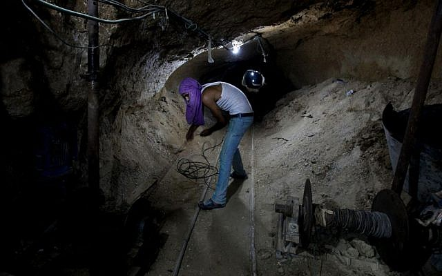Working in a Palestinian smuggling tunnel connecting Gaza and Egypt in 2013. (photo credit: Hatem Moussa/AP)
