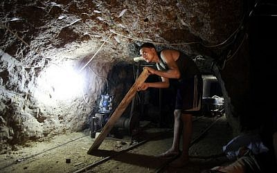 Illustrative: Working in a smuggling tunnel between Gaza and Egypt (photo credit: Hatem Moussa/AP)